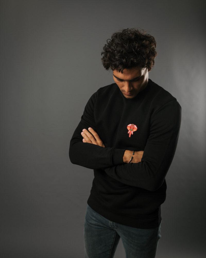 Black sweatshirt red logo OMNIA IN UNO